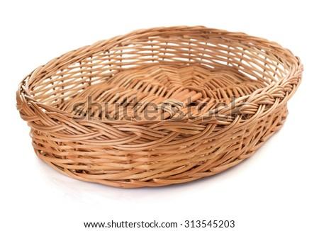 wicker basket isolated on white background - stock photo
