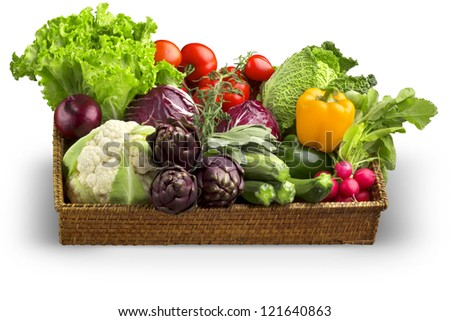 wicker basket of fresh vegetables isolated on white background - stock photo
