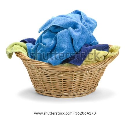 Wicker Basket with Messy Towels Isolated on White Background. - stock photo