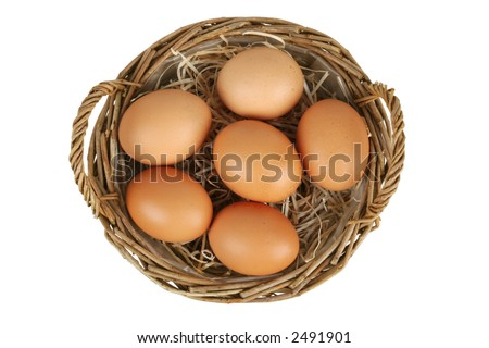 Wicker basket with six brown eggs. Top view. Isolated on white.  Clipping path included. - stock photo