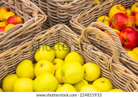 Wicker baskets with fresh apples - stock photo