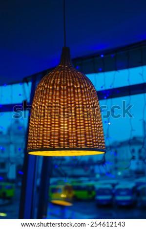 wicker lamp in the interior. - stock photo