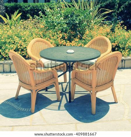 wicker seats on the mediterranean hotel terrace, Crete, Greece. square toned image - stock photo