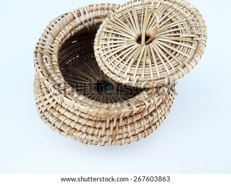 Wicker small basket on white background, handicraft vintage casket with cover - stock photo