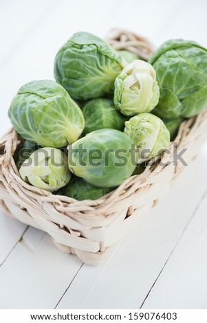 Wicker tray with brussels sprouts, high angle view - stock photo