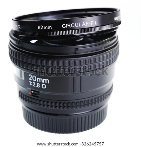 Wide angle fixed range 20mm lens isolated on white. - stock photo
