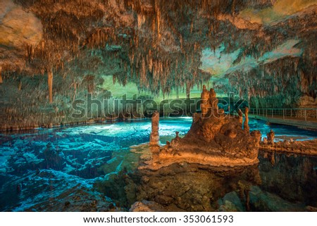 Wide angle long exposure of caves lake with stalactites and stalagmites - stock photo