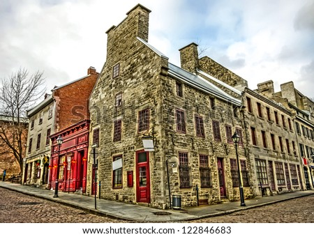Wide angle of Corner Street, and Old Architectural buildings in the heart of Old Montreal, HDR image. (With some digital noise) - stock photo