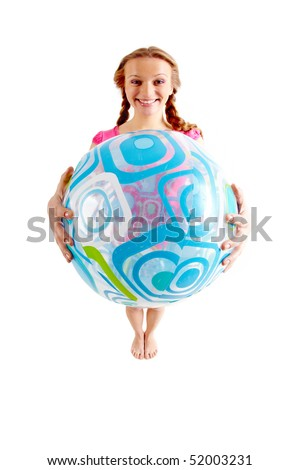 Wide angle of joyful teenage girl with inflatable ball on white background - stock photo