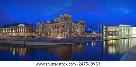 wide angle panoramic view of  the German parliament building (Reichstag) and river Spree at evening, Parliament district, Berlin, Germany, Europe  - stock photo