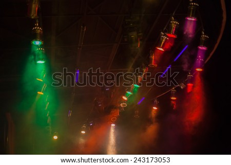 Wide angle photograph of the spotlights at the stage - stock photo