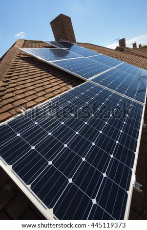 Wide Angle Shot of Solar Panels installed on Tiled Roof - stock photo