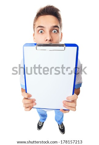 Wide angle top view of surprised young doctor showing empty clipboard isolated on white background - stock photo