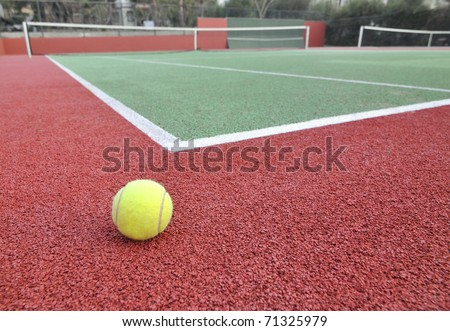 Wide angle view of a tennis court. Shallow DOF. - stock photo