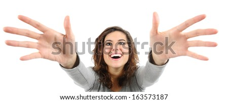 Wide angle view of a woman trying to reach something isolated on a white background             - stock photo