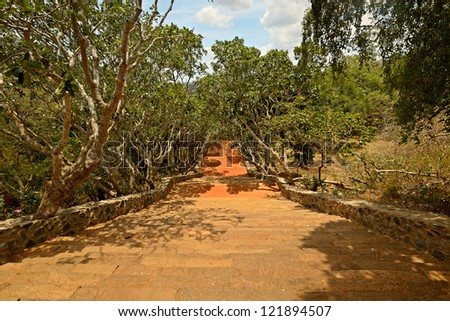 Wide angle view of ancient stone staircase in Mihintale, Sri Lanka - stock photo