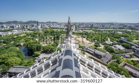 Wide angle view of Himeji from top of the castle - stock photo