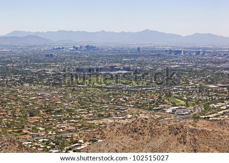 Wide Angle view of Phoenix, Arizona Skyline looking from the northeast to the southwest - stock photo