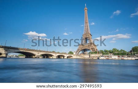 Wide angle view of The Eiffel Tower and Seine river, long exposure in Paris, France - stock photo