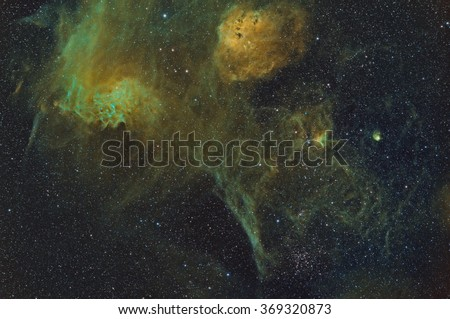 Wide Angle view of the Flaming Star, Tadpole and other nebulae and star clusters in the Constellation Auriga - stock photo