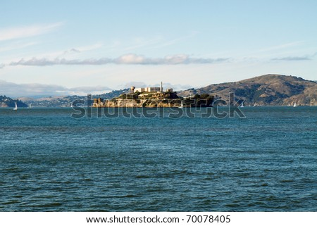Wide angle view of The Rock, Alcatraz in San Francisco harbor, in horizontal orientation with copy space for text - stock photo