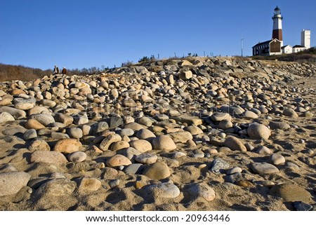 Wide angle view of the rocks leading up to the Montauk Point Lighthouse. Long Island, NY - stock photo