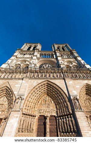 Wide-angle view of West facade, Cathedral Notre Dame de Paris (1160-1345), Paris, France - stock photo