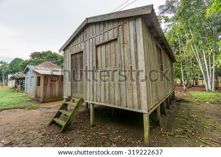 Wide angle view of wooden house built in Amazon rainforest, Brazil - stock photo