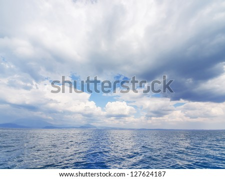 Wide angle view on seascape with stormy clouds , lake Lago Di Garda, Italy - stock photo