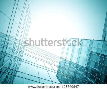 wide angle view to dark high rise skyscrapers at night - stock photo