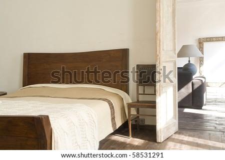wide bed near door - stock photo