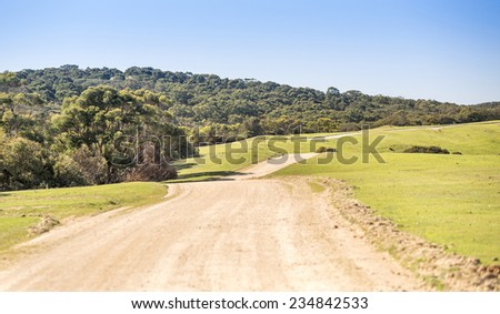 Wide country road winding off into the distance in South Australia - stock photo