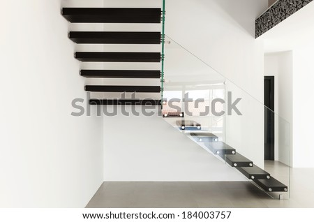 wide empty living room, interior of a modern house - stock photo