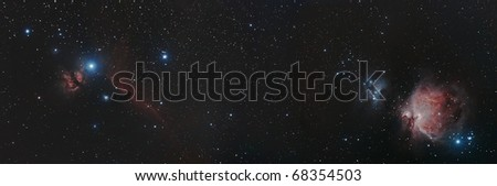 Wide Field View of the Horse Head and Flame and the Orion Nebula - stock photo