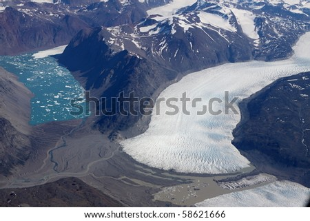Wide ice area by the turquoise lake at the Greenland coast - stock photo