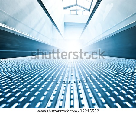 wide long escalators way inside contemporary airport - stock photo