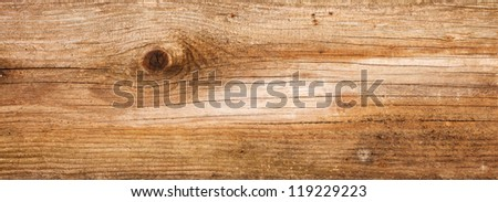 Wide natural fir wood texture with cracks and knots - stock photo