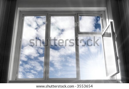Wide open window. B/w frame, blue sky and bright sunlight. Concept image. - stock photo