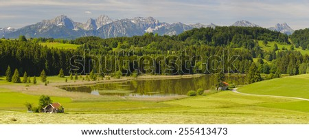wide panorama landscape with lake and alps mountains in Bavaria, Germany - stock photo