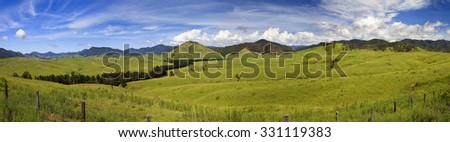 wide panorama of green cultivated valley in remote agricultural hills country of NSW, Australia - stock photo