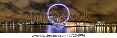 Wide panorama of London Eye and river Thames - stock photo