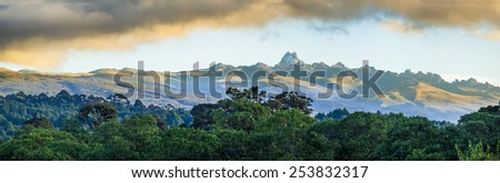 wide panorama of mount Kenya at dawn - stock photo