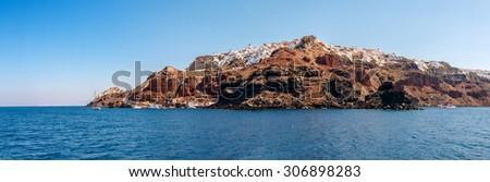 Wide panorama of Oia town from the sea on Santorini island, Greece - stock photo