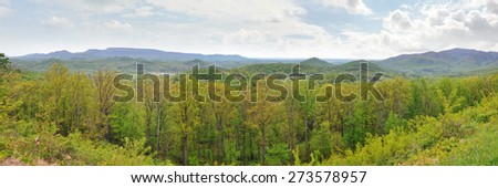 Wide panorama of the Appalachian Mountains in April with fresh green spring leaves - stock photo