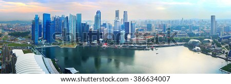 Wide panoramic aerial view of Singapore at beautiful sunset - stock photo