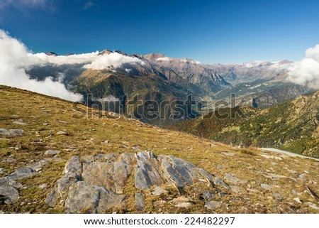 Wide panoramic view in autumn of the italian western Alps. - stock photo