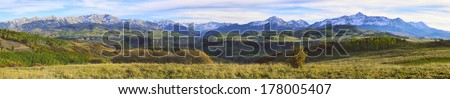 wide panoramic view of the colourful mountains of Colorado during foliage season - stock photo