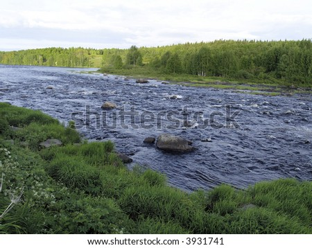 Wide river with stones - stock photo