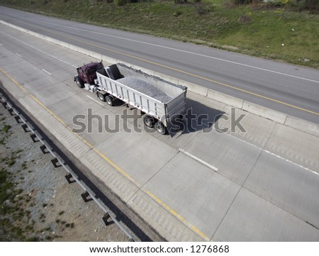 Wide Shot of Semi with Load of Gravel - stock photo