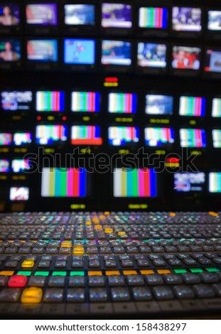 Wide shot of vision mixing panel in a television gallery. Very narrow depth of field. - stock photo